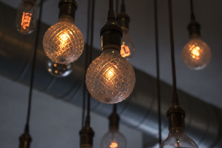 Coffee Shop Close-up Electric Lamp Electric Light Electricity  Filament Focus On Foreground Hanging Illuminated In A Row Indoors  Lantern Light Bulb Lighting Equipment Low Angle View No People Business Stories EyeEmNewHere