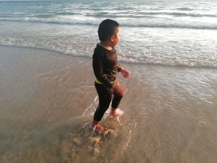 Children enjoy on summer trip 2019,หาดเจ้าหลาว Achi2019 Child Childhood Water Sea One Person Real People Beach Boys Lifestyles Land Males  Leisure Activity Motion Full Length Men Day Nature Casual Clothing Outdoors Innocence