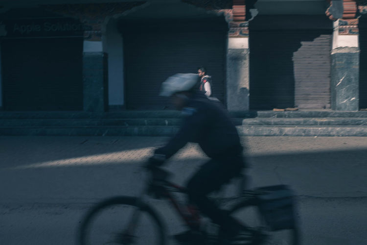Morning starts around 8 in this peace-loving country, especially in winters. Bicycle Motion One Person Blurred Motion Transportation Ride Real People Riding Side View Street Outdoors