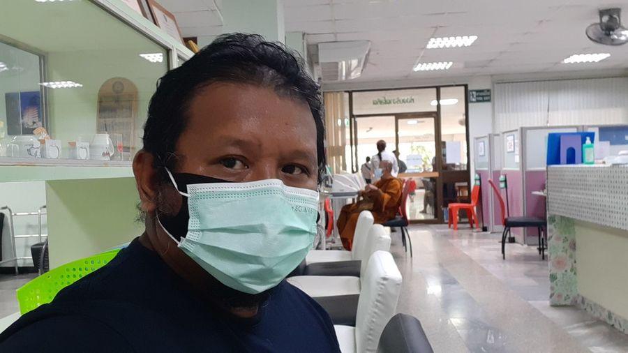 Portrait of man working in office