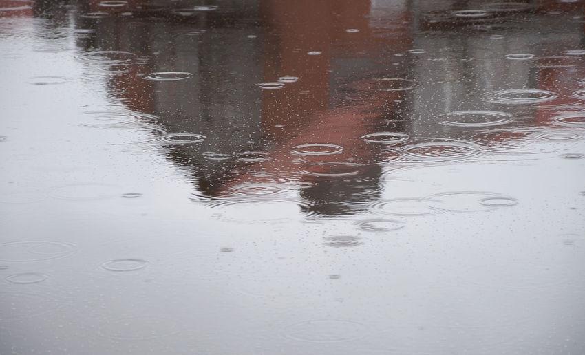 Wet glass window in rainy season