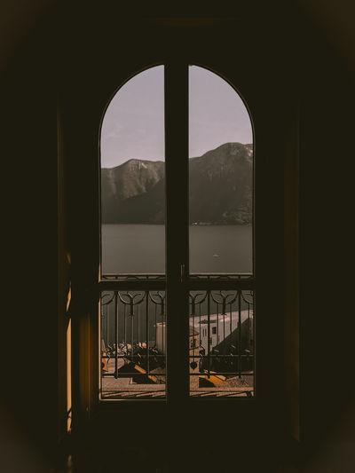 Silhouette building seen through window