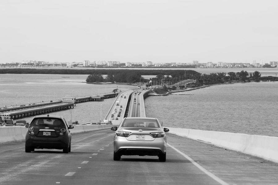 Blackandwhite Road Signal Cars Motorway Horizon Over Water Welcome To Black Black & White Friday Mobility In Mega Cities