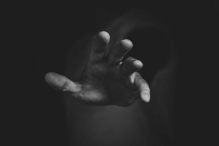 Close-Up Of A Human Hand Against Blurred Background