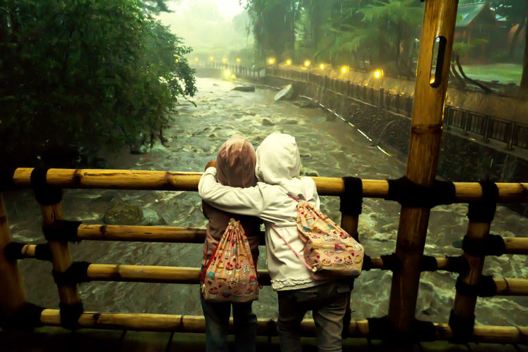 Sisters are forever Sister Sisterhood SisterhoodMoment Bench Casual Clothing Day Emotion Full Length Leisure Activity Lifestyles Nature Park Park Bench People Plant Positive Emotion Railing Real People Rear View Seat Sitting Tree Two People Warm Clothing Women