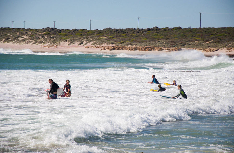 Families in the foamy Indian Ocean waves bodyboarding at Jake's Point beach in Kalbarri, Western Australia. Adventure Beach Bodyboard BodyBoarding Family Foamy Indian Ocean Jake's Point Kalbarri Leisure Activity Lifestyles Nature Real People Recreational Pursuit Sea Sport Summer Togetherness Tourists Travel Destinations Turquoise Vacation Water Wave Western Australia