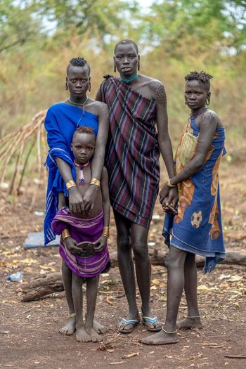 Mursi Village Mursi Portrait Of A Woman Portrait Photography Tribal Portraits Tribe Tribes Ethiopia Ethiopian African Omo Valley Africa Ethiopian Photography 🇪🇹 Group Of People Full Length People Males  Togetherness Childhood Child Day Outdoors Looking At Camera Offspring Standing Women Females Girls Lifestyles