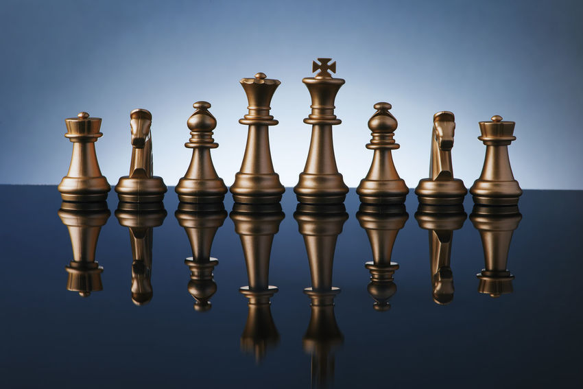 chess set with gradient background Golden Reflection Blue Challenge Chess Chess Board Chess Piece Close-up Color Concept Day Defense Focus Gradient Background King - Chess Piece Knight - Chess Piece Low Key Lighting Queen - Chess Piece Strategy Strong Defence
