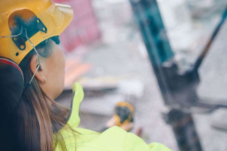 Close-up of woman at construction site