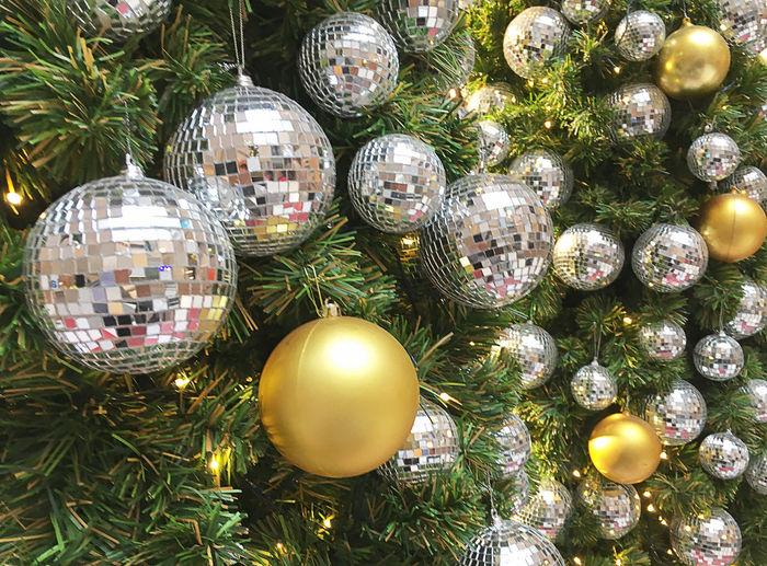 Christmas Celebration Decoration Holiday Christmas Decoration Christmas Ornament christmas tree No People Sphere Illuminated Event Celebration Event Tree Close-up Shiny Christmas Lights Holiday - Event Lighting Equipment Indoors  Silver Colored Golden Balls