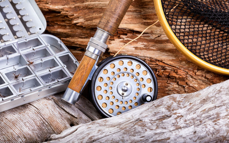 Antique fly fishing gear on drift wood Antique Close-up Directly Above Drift Wood  Equipment Fishing Fly Fishing Gear No People Old Outdoors Sport Vintage Wood - Material