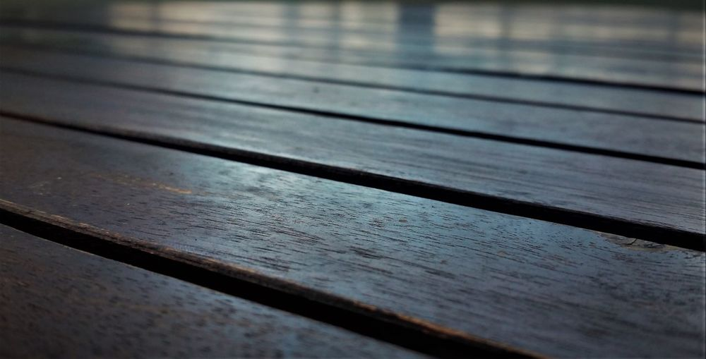High angle view of boardwalk on wooden table