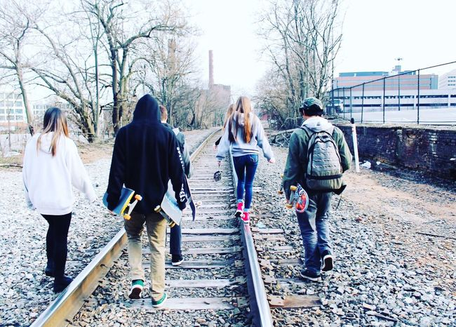 Tracks... Leisure Activity Lifestyles Togetherness Bare Tree Bonding Warm Clothing Friendship Large Group Of People Casual Clothing Rear View Tree The Way Forward City Footpath Day Person Park - Man Made Space Sky Diminishing Perspective Outdoors