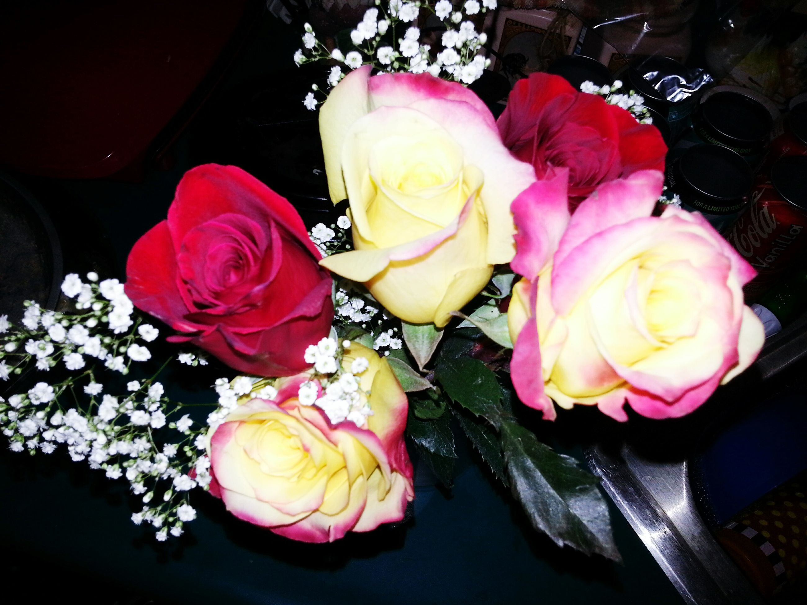 flower, rose - flower, petal, freshness, flower head, fragility, rose, indoors, beauty in nature, bouquet, vase, close-up, pink color, bunch of flowers, high angle view, flower arrangement, nature, blooming, table, decoration
