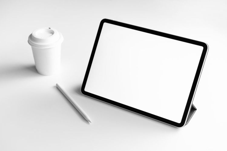 Tablet screen blank on the table mock up to promote your products. Concept of future and trend internet for easy access to information. Technology Wireless Technology Communication Connection Copy Space Screen Digital Tablet Studio Shot Device Screen Indoors  Blank No People White Background Food And Drink Mobile Phone White Color Smart Phone Computer Portable Information Device Portability