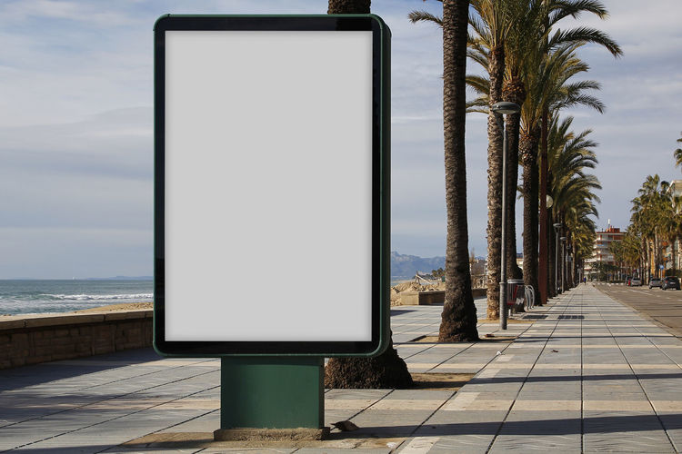 Blank billboard mock up Tree Nature Plant Day Outdoors No People Copy Space Blank Billboard Advertisement Advertising Mock Up Copy Space Branding Brand Street City Beach Tree Palm Tree Sea Water Seascape