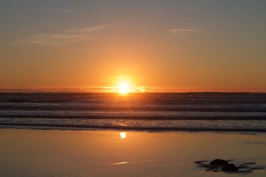 Beach Sunsets Sunset Sun Beauty In Nature Scenics Nature Sea Beach Tranquil Scene Tranquility Sky Water Ngarunui Raglan New Zealand Orange Color EyeEmNewHere No People Idyllic Reflection Horizon Over Water Sunlight Outdoors Silhouette Sand
