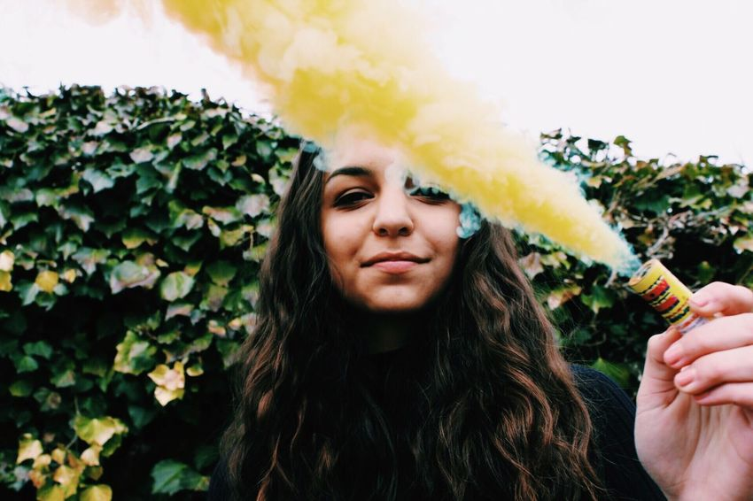Smoke Smoke Bomb Yellow One Person Front View Portrait Outdoors Long Hair One Woman Only Young Adult Leisure Activity One Young Woman Only Adults Only Real People Nature Lifestyles Beauty Adult Headshot Young Women Women Beautiful Woman Day