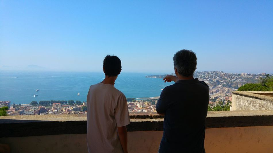 Two People Rear View Adult Togetherness Adults Only Men Sky Sea Cityscape Standing Outdoors Friendship Only Men Nature Young Adult Napoli Naples, Italy Bay Of Naples Talking The Week On EyeEm Done That. Stories From The City