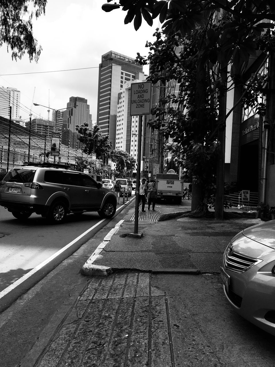 CITY STREET BY BUILDINGS