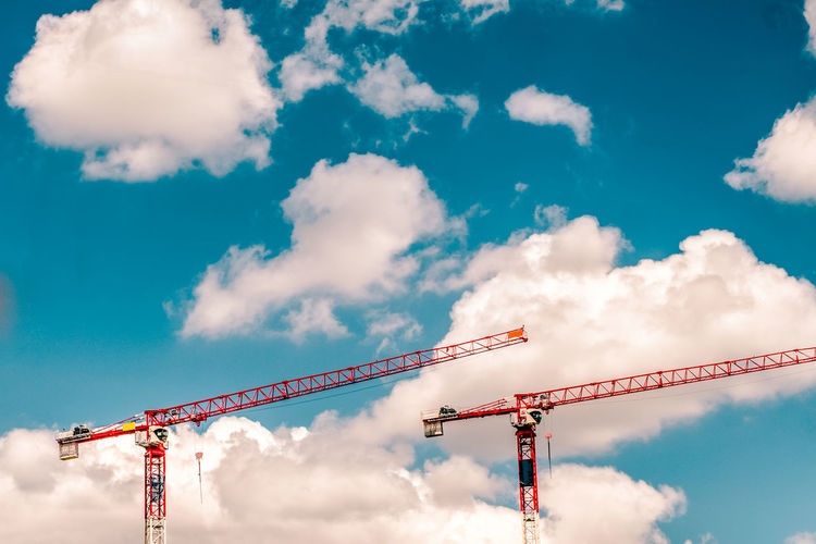 Cloud - Sky Construction Site Crane Crane - Construction Machinery Day Low Angle View No People Outdoors Red Crane Sky Symetric Two Cranes