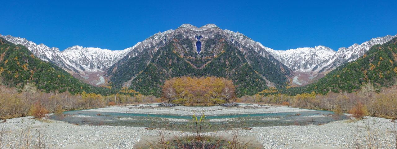 natural Japanese alps mountain at kamikochi nagano japan Japan Beauty In Nature Blue Clear Sky Day Environment Kamikochi Landscape Mountain Mountain Peak Mountain Range Nagano Nature No People Outdoors Plant Scenics - Nature Sky Snow Solid Tranquil Scene Tranquility Travel Destinations Tree Water