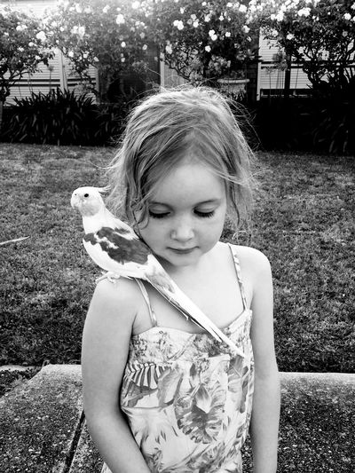Girl With Bird On Shoulder At Yard