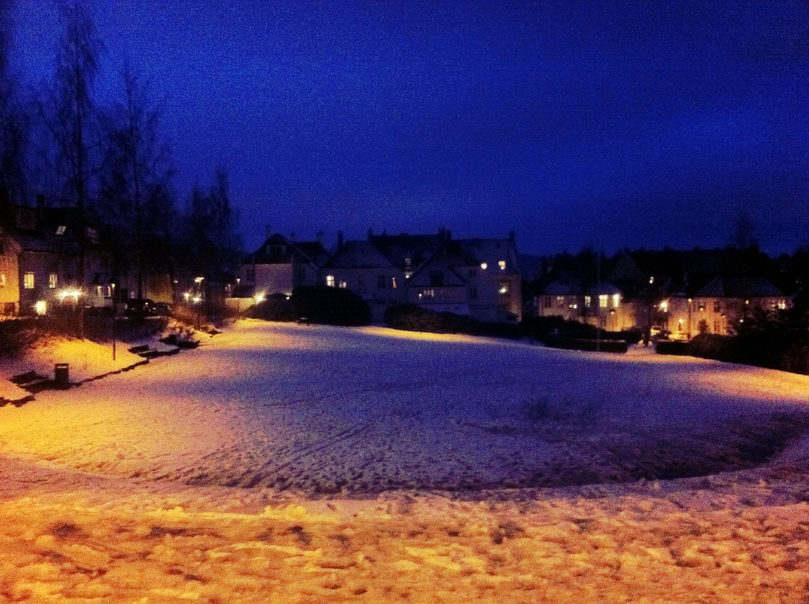 night, illuminated, blue, landscape, sky, snow, tranquility, tranquil scene, winter, scenics, field, cold temperature, nature, tree, beauty in nature, road, star - space, outdoors, dusk, street light