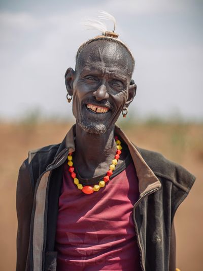 Dassanech Tribe Man in Omorate / Ethiopia Ethiopia Ethiopian Photography 🇪🇹 Travel Travel Destinations Omo Valley Omovalley Africa Portrait Photography African Dassanech Tribe Portrait One Person Front View Smiling Real People Focus On Foreground Adult Looking At Camera Happiness Sky Casual Clothing Jewelry Day Men Waist Up Standing Hairstyle Lifestyles Emotion Outdoors EyeEmNewHere