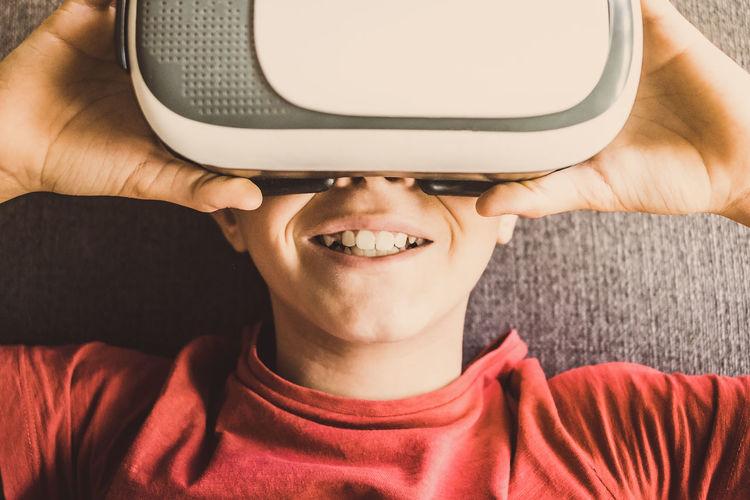 Close-up of boy wearing virtual reality sunglasses