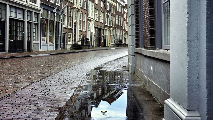 Rainy Days Rainy Day Cityscape City View  Discover Your City Walking Around The City  Reflection Reflections Peace And Quiet Water Reflection House Streetphoto_color Street Sony NEX Walking Enjoying Life Romantic Eyeemphotography Sunday City Life Urban Lifestyle Street Life