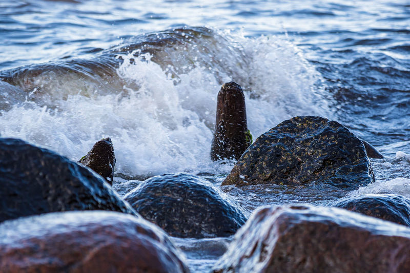Waves splashing on rocks at shore