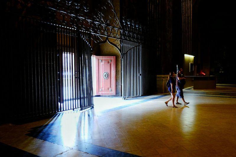 Full length of woman walking in illuminated building