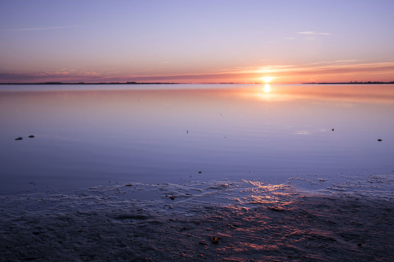 Delta de l'Ebre Water Sunset Sky Tranquility Scenics - Nature Beauty In Nature Tranquil Scene Sea Sun Nature No People Reflection Idyllic Beach Cloud - Sky Land Orange Color Horizon Over Water Outdoors Salt Flat Sunrise