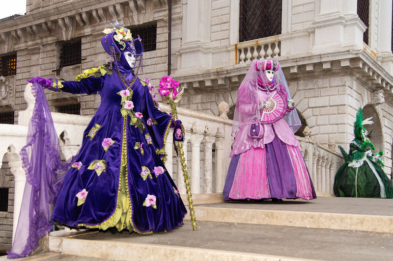 Carnival in Venice Carnival In Venice Adult Architecture Arts Culture And Entertainment Building Exterior Built Structure Celebration Costume Cultures Day Flowers Mask - Disguise Outdoors People Performance Performing Arts Event Period Costume Stage Costume Venetian Mask The Street Photographer - 2018 EyeEm Awards The Portraitist - 2018 EyeEm Awards