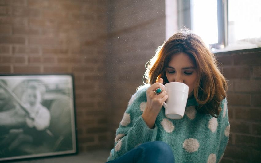 Mid Adult Woman Drinking Coffee At Home