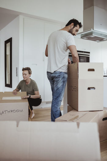 Full length of young couple standing in box