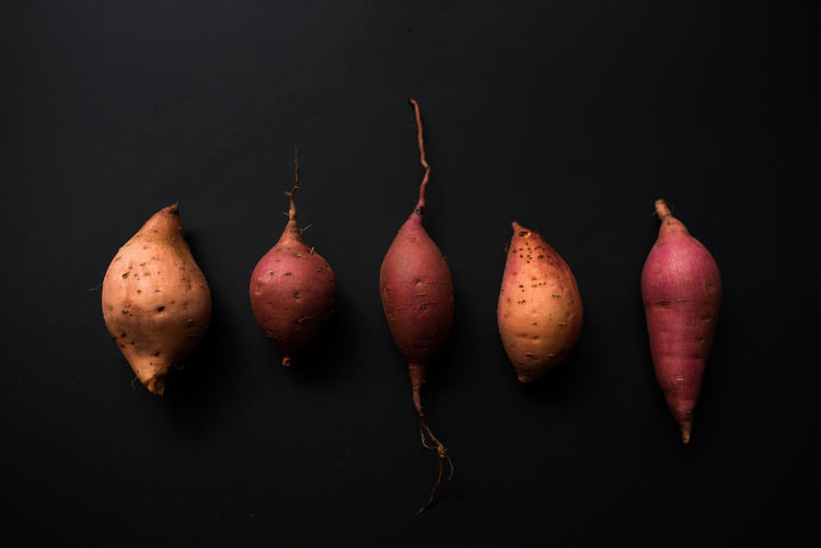 Sweet potato study EyeEmNewHere Black Background Close-up Day Food Food And Drink Freshness Healthy Eating Indoors  No People Organic Still Life Studio Shot Sweet Potatoes