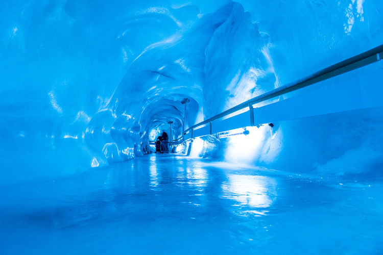 Adventure Beauty In Nature Blue Cold Temperature Day Enjoyment Frozen Glacier Cave Ice Ice Rink Ice-skating Leisure Activity Motion Nature One Person Outdoors Real People Sport Swimming Swimming Pool Underwater Vacations Water Winter Winter Sport