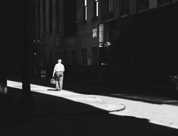 Take the scenic route Sunlight Walking Street Shadow One Person Architecture Full Length Real People Men Outdoors City One Man Only Day People Adult City Life EyeEm Best Shots The Street Photographer - 2017 EyeEm Awards