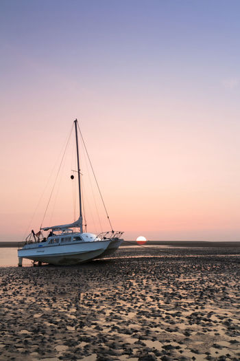A picture from the sunset on Borkum with a boat that stranded to stay the night at the beach... Beach Boat Borkum Day Deutschland Evening Germany Island Nature Nautical Vessel No People Outdoors Sailboat Sailing Sailing Ship Sea Ship Sky Stranded Sunset Sunset_collection Water