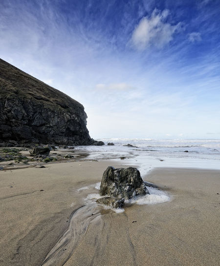 The tide comes in at Chapel Porth, Cornwall Beach Sea Sky Land Beauty In Nature Water Rock Scenics - Nature Rock - Object Solid Nature No People Tranquil Scene Tranquility Sand Cloud - Sky Rock Formation Day Motion Horizon Over Water Outdoors Rocky Coastline Chapel Porth Cornwall Coast