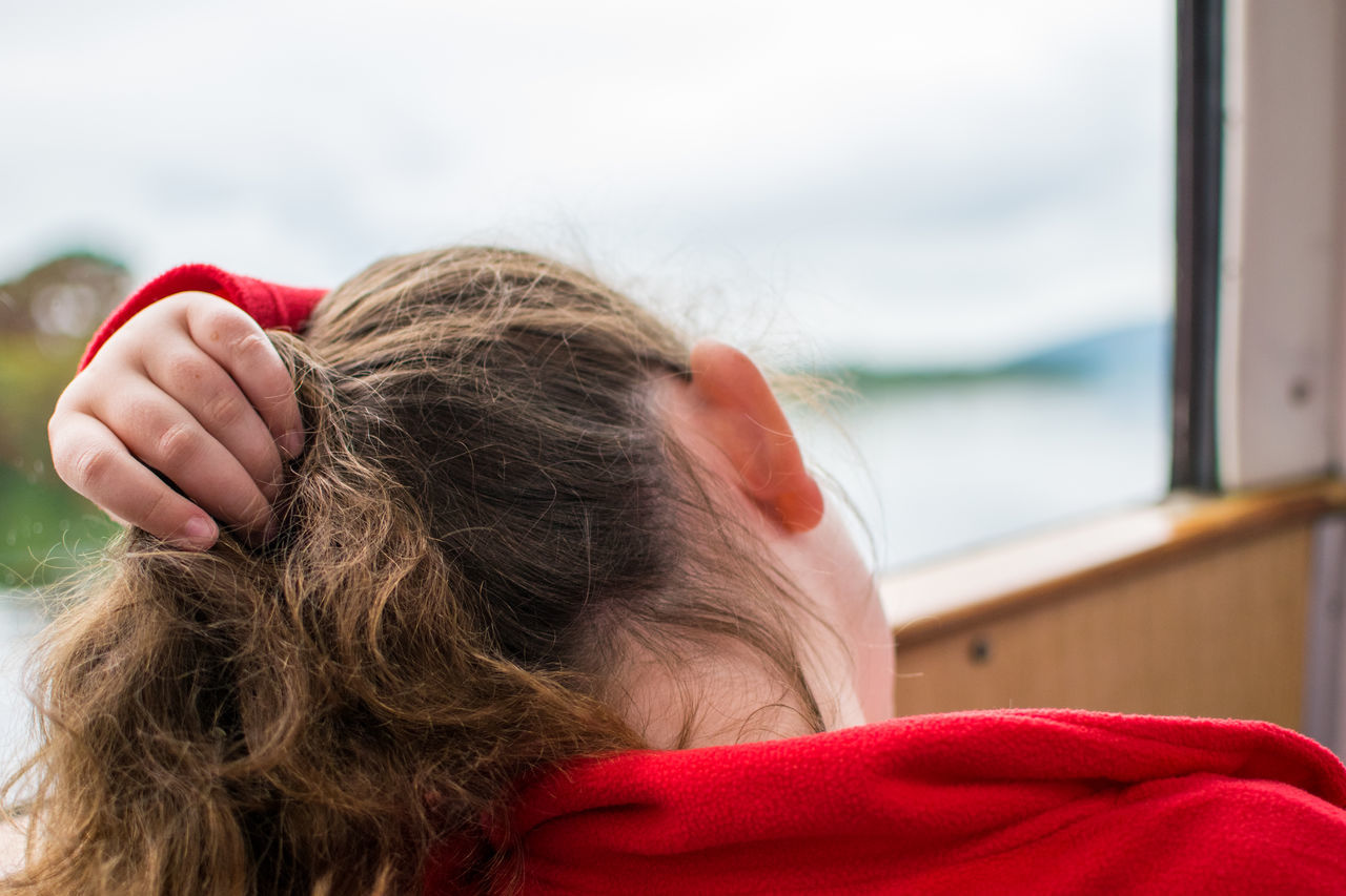 Rear view of girl traveling in ferry
