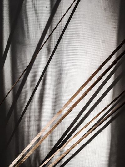 Wood against curtain