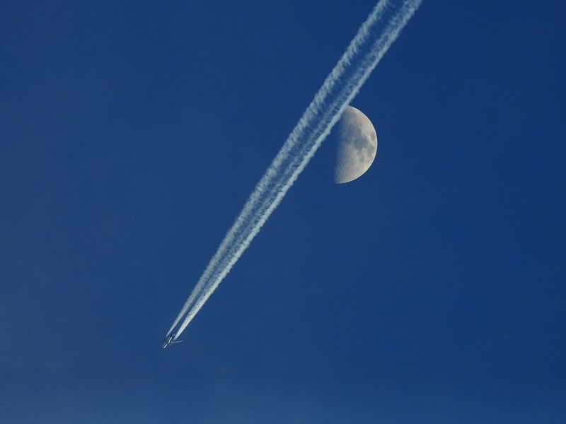 An Eye For Travel Moon Moon Shots Safe Travels! Travel Photography Air Vehicle Airplane Beauty In Nature Blue Blue Sky Clear Sky Contrail Half Moon Moon Moon_collection Nature Outdoors Scenics Sky Speed Transportation