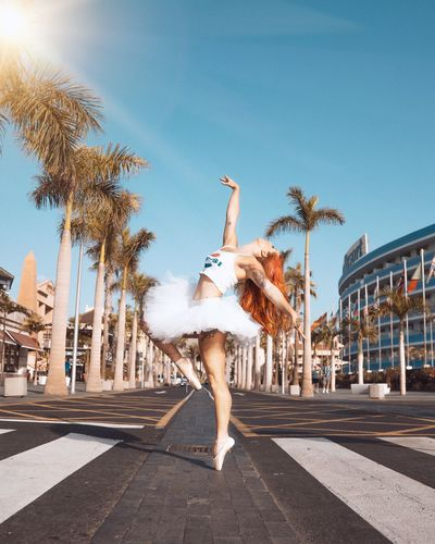 Fly Young Adult Young Women One Person Women City Sky Clothing Architecture Dancing Sunlight Day Fashion Arts Culture And Entertainment Adult Street Nature Limb Motion Beauty Road EyeEmNewHere