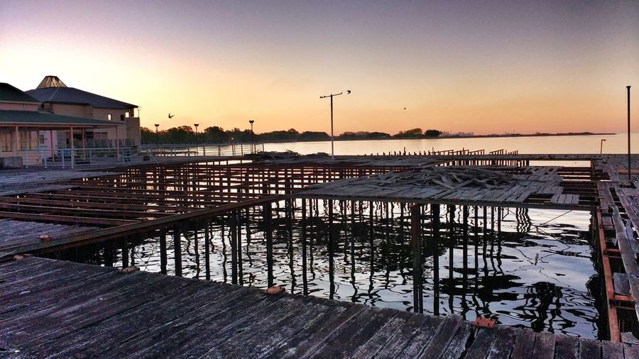 Water Sky Horizontal Outdoors Sunset Buenosaires Atardecer Argentina Photography Quilmes Quilmes2016 Sunset Sky Water Dusk Horizontal Outdoors No People Bird Bridge - Man Made Structure Beauty In Nature Nature Day