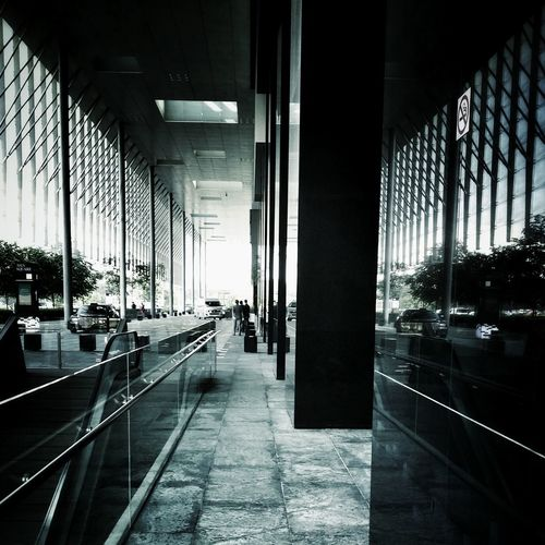 """""""Up ahead in a distance I saw a simmering light"""" Urban Geometry Architecture Vanishing Point Monochrome Geometric Shapes Darkness And Light"""