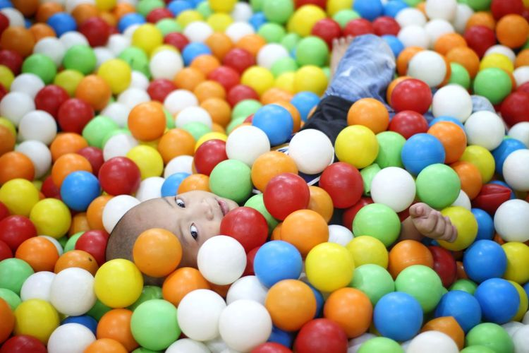 Portrait of boy in colorful ball pool