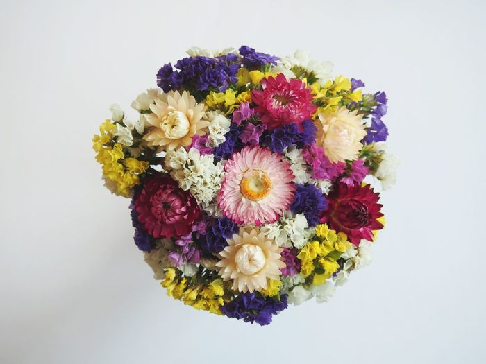 Close-up of colorful bouquet against white background